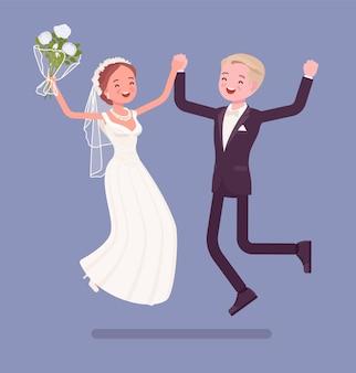 Les mariés sautent heureux lors de la cérémonie de mariage