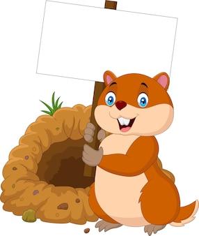 Marmotte de dessin animé tenant une pancarte blanche