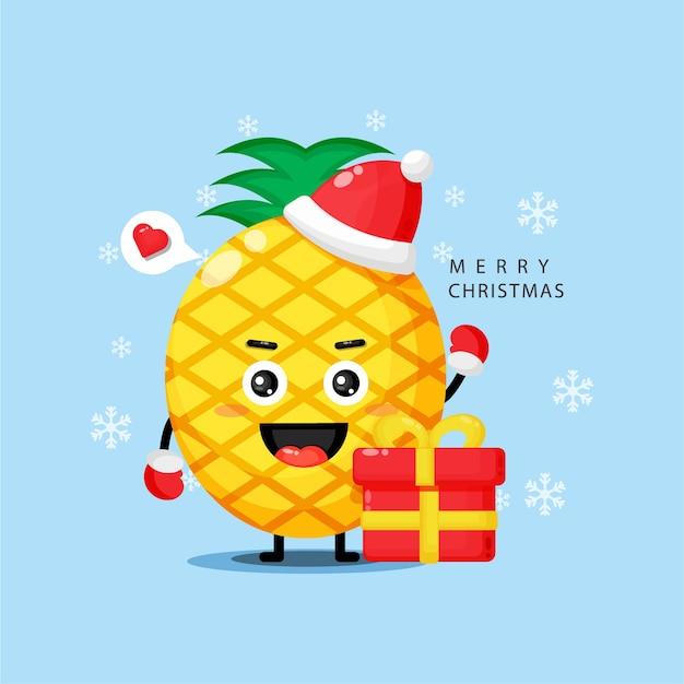 Mascotte d'ananas mignon célébrant le jour de noël
