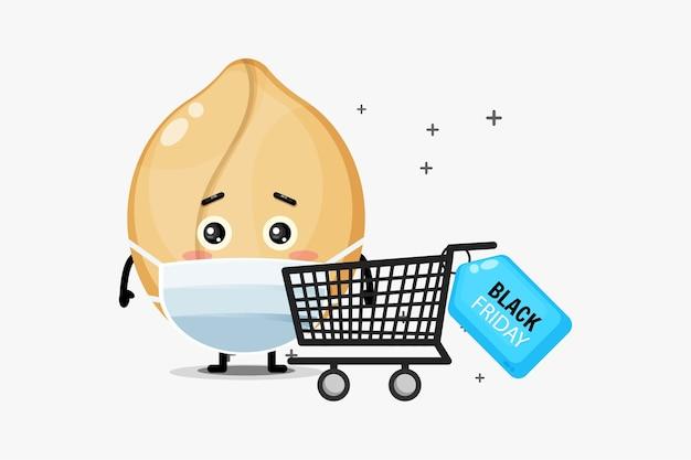 Mascotte d'arachide mignonne shopping à l'aide de masques médicaux