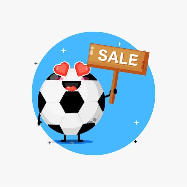 Mascotte de ballon de football mignon avec le signe des ventes