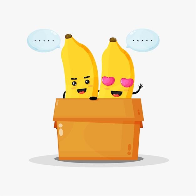 Mascotte de banane mignonne dans la boîte