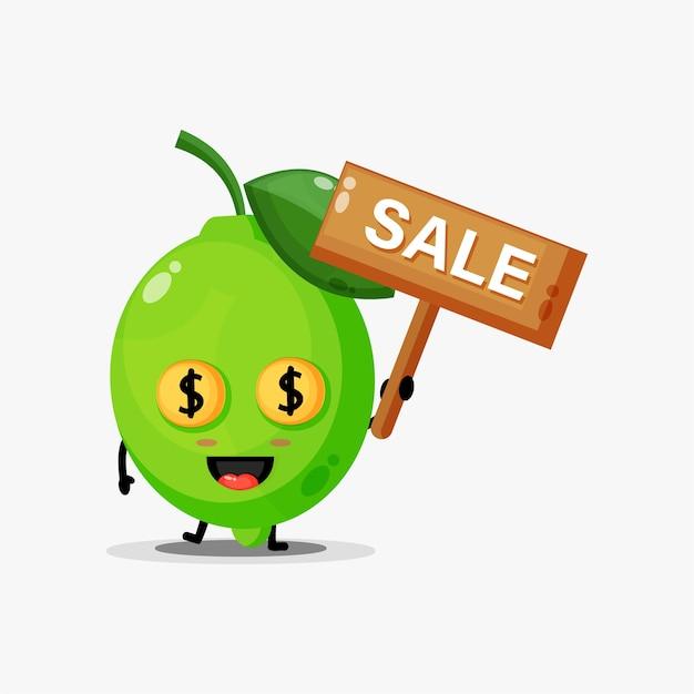 Mascotte de citron vert mignon avec le signe des ventes