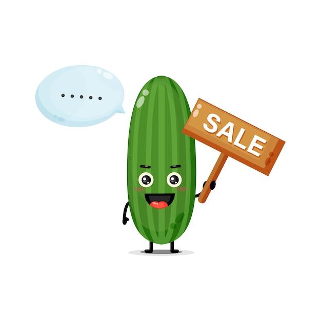 Mascotte de concombre mignon avec le signe des ventes