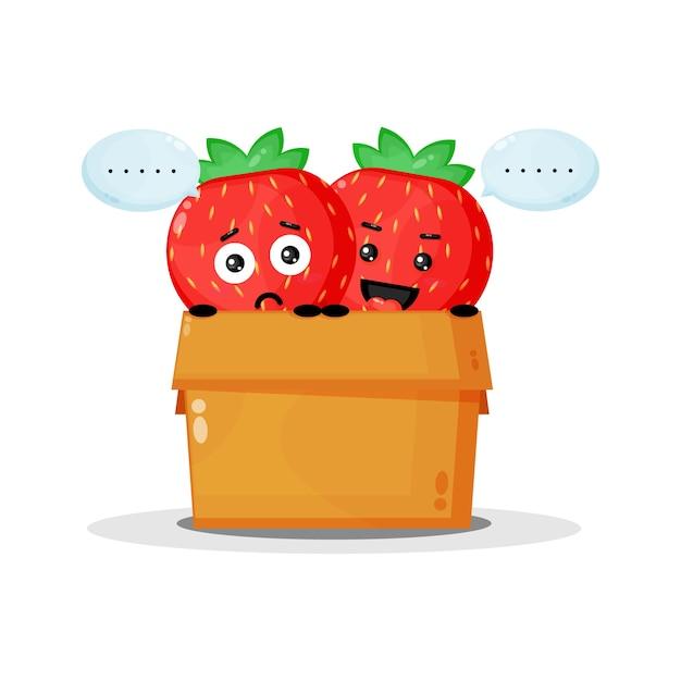Mascotte de fraise mignonne dans la boîte