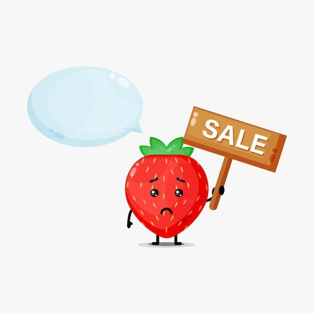 Mascotte de fraise mignonne avec le signe des ventes
