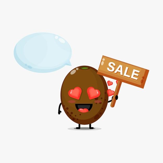 Mascotte de kiwi mignon avec le signe des ventes