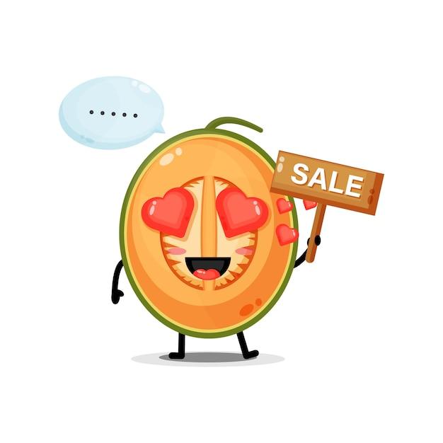 Mascotte de melon mignon avec le signe des ventes