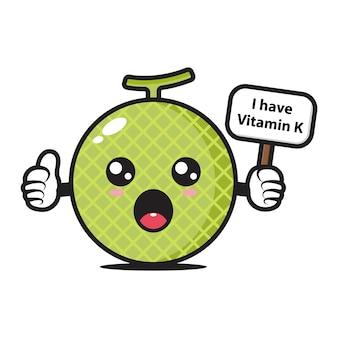 Mascotte melon tenant une planche qui dit que j'ai de la vitamine k