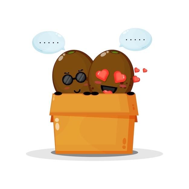 Mascotte mignonne de kiwi dans la boîte