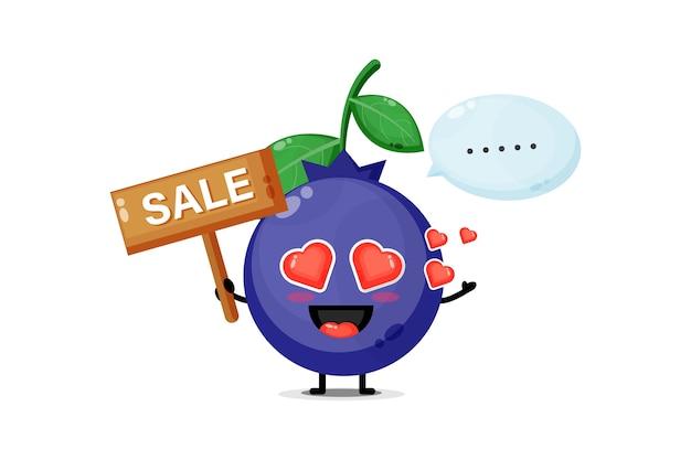 Mascotte de myrtille mignonne avec le signe des ventes