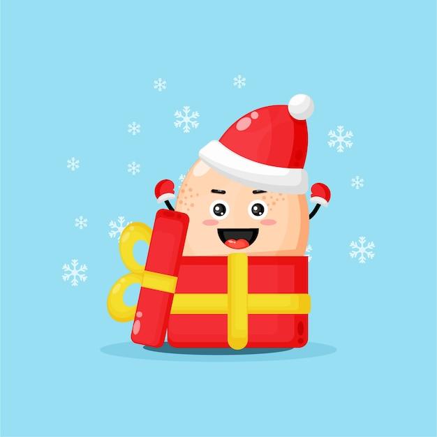 Mascotte d'oeuf de poule mignonne dans une boîte cadeau portant un chapeau de noël