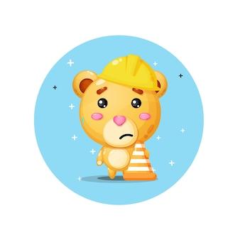 Mascotte d'ours mignon travaille dans la construction