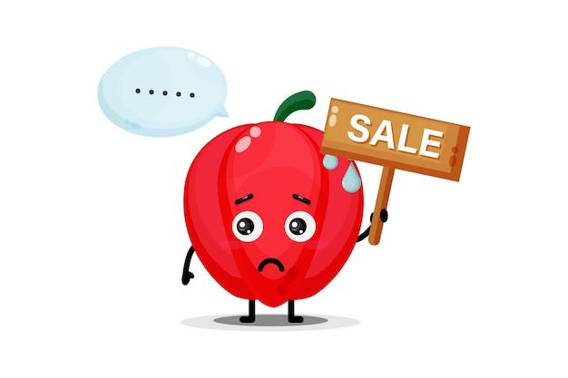 Mascotte de poivron mignon avec le signe de vente