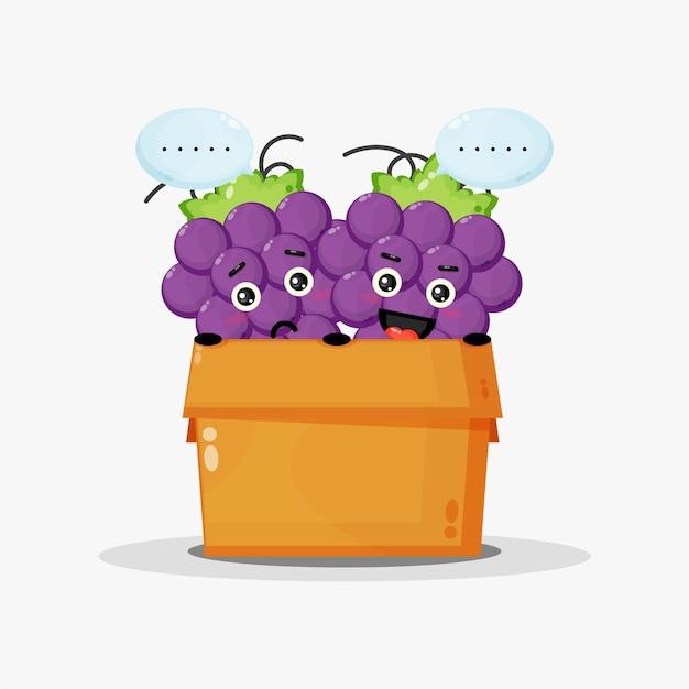 Mascotte de raisin mignon dans la boîte
