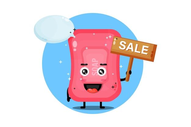 Mascotte de savon mignon avec le signe des ventes