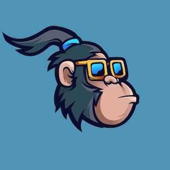 Mascotte de singe avec des lunettes. singe aux cheveux longs