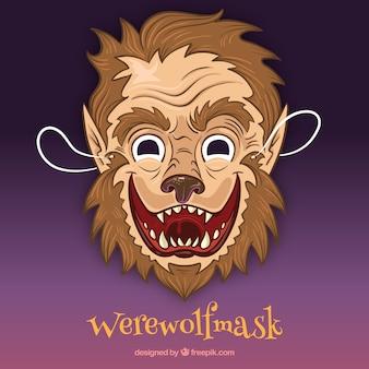 Masque de loup-garou à la main