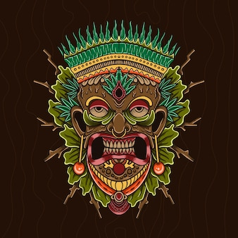 Masque tribal hawaïen traditionnel tiki avec visage humain et feu brûlant symbole de totem en bois