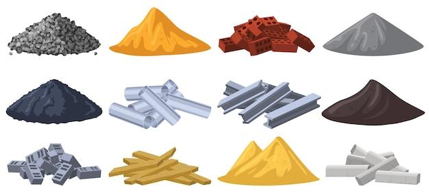 Matériaux de construction. pieux de matériaux de construction, gravier, sable, briques et tas de pierres concassées