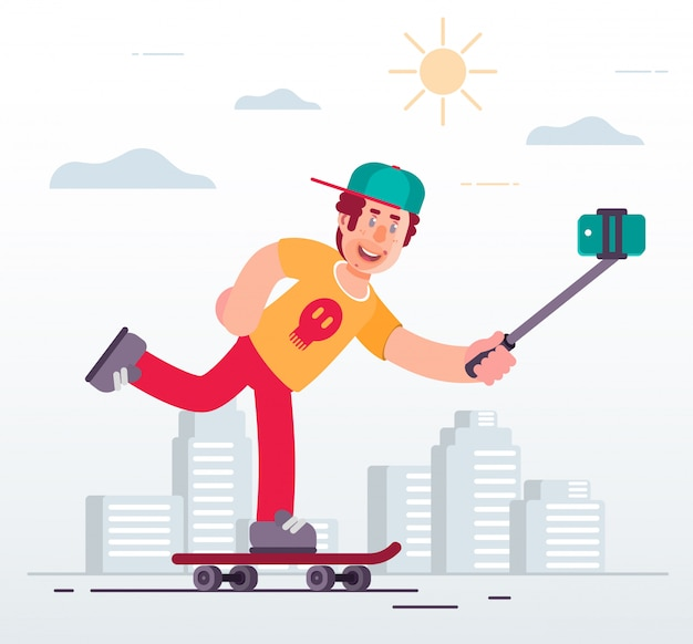 Un mec fabrique un selfie par téléphone en faisant du skateboard