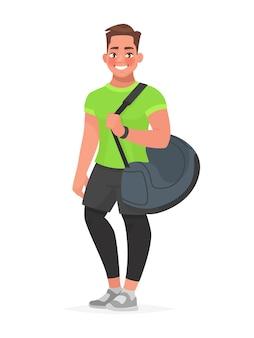 Mec de remise en forme avec un sac de sport sur blanc. entraîneur ou visiteur de gym.