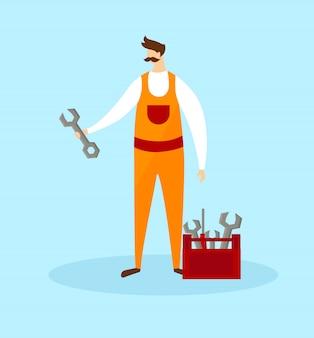 Mécanicien en combinaison orange, tenant une clé à la main