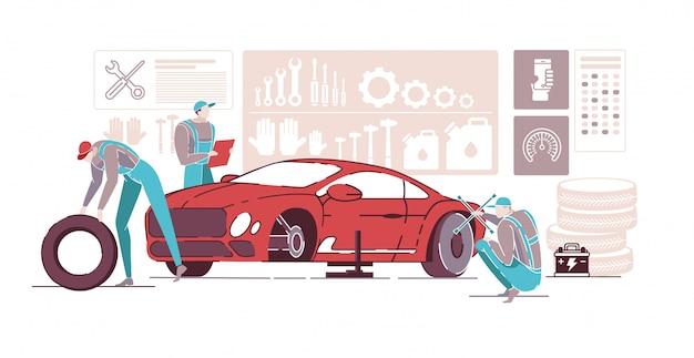 Mécaniciens automobiles travaillant dans le service de réparation automobile.