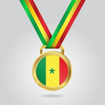 Médaille d'or avec le drapeau du sénégal