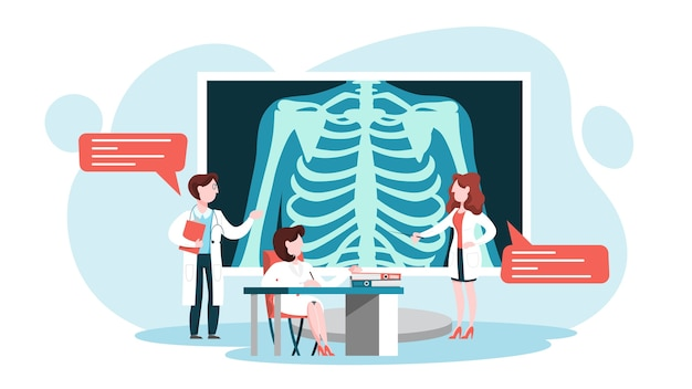 Médecin debout autour d'une grande image radiographique de la poitrine
