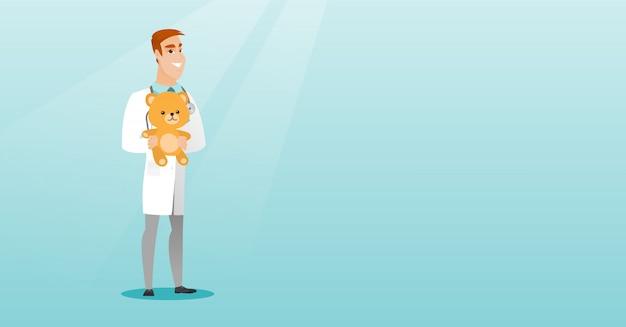 Médecin pédiatre tenant ours en peluche.