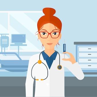 Médecin avec une seringue dans la salle d'hôpital.