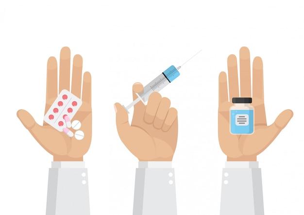 Le médecin tient dans les mains des pilules, des capsules et une seringue.