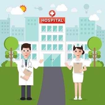 Médecins posant devant l'hôpital