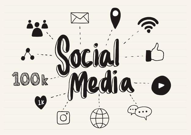 Les médias sociaux griffonnés sur un bloc-notes