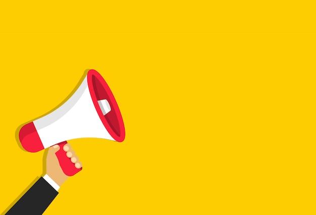 Mégaphone à la main en style cartoon. haut-parleur pour annonce ou information importante.