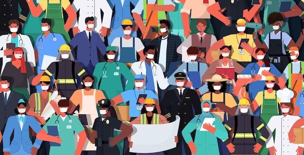 Mélanger les gens de race de différentes professions debout ensemble concept de célébration de la fête du travail hommes femmes portant des masques pour prévenir l'illustration vectorielle horizontale de coronavirus
