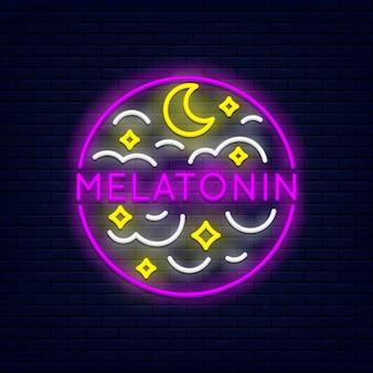 Mélatonine néon coloré au mur de briques
