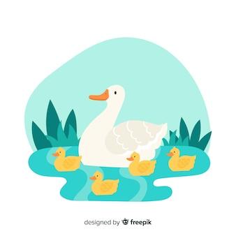 Mère canard et ses canetons ensemble sur l'eau