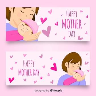 Mère embrassant bannière de fête des mères de bébé