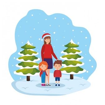 Mère et enfants dans le paysage de neige
