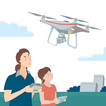 Mère et fille jouant avec drone dans le parc