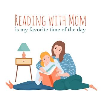 Mère et fille lisant ensemble assis sur le sol, maman étreignant son enfant et montrant quelque chose dans le livre