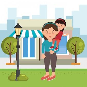 Mère avec fille sur le parc
