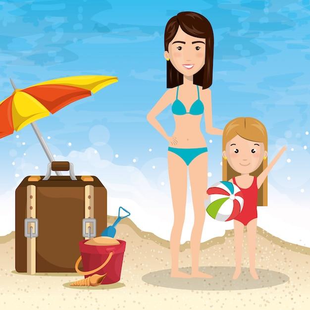 Mère avec fille sur la plage