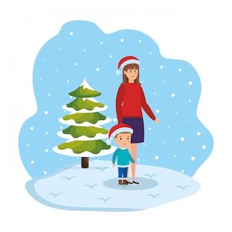 Mère et fils dans le paysage de neige