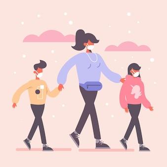 Mère marchant avec ses enfants portant un masque