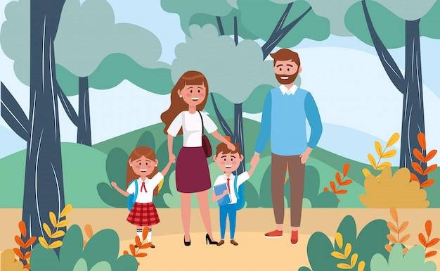 Mère et père avec leurs élèves filles et garçons dans le paysage