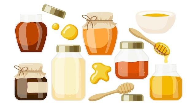 Miel d'abeille de différentes variétés dans des bocaux en verre et un bol en bois cuillère à miel gouttes de miel