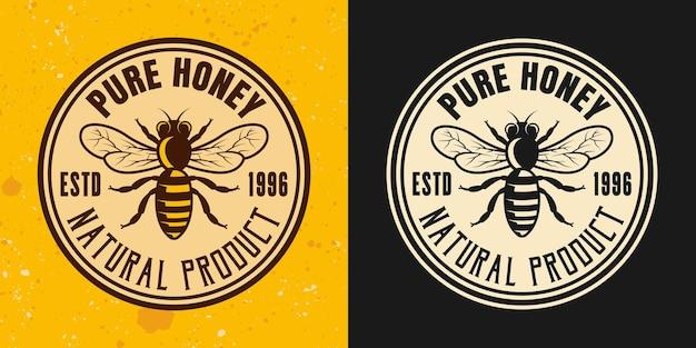 Miel pur deux styles vectoriels emblème, insigne, étiquette ou logo sur fond jaune et foncé